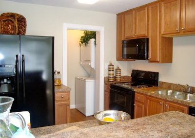 Washer, dryer, refrigerator, microwave, stove, oven kitchen island