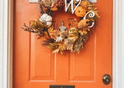 Orange Door with wreath